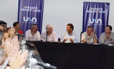 Ghione y Colella junto a Massa en una reunión del Frente Renovador